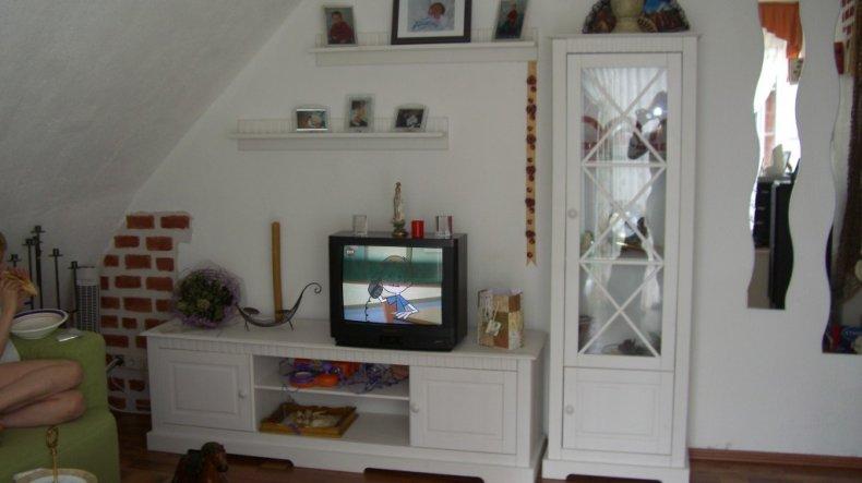 Wohnzimmer Unten links von Bild, sind 3d Ziegelstein optik gesetzt worden die sich in der unteren helfte des Wohnberreich befinden.