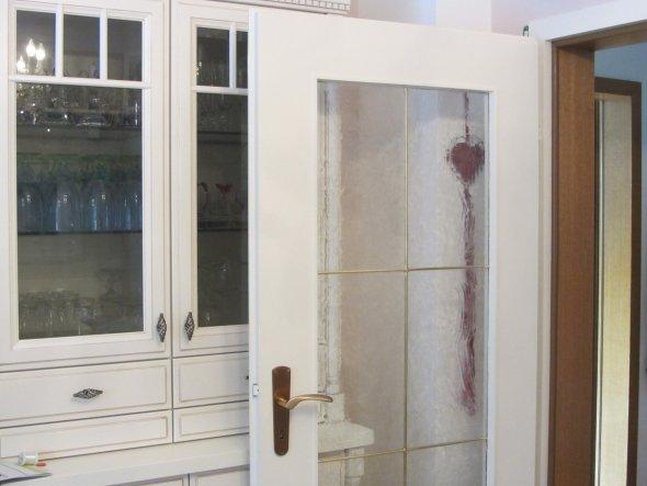 Türe und Türrahmen vorher in Eiche rustikal, jetzt passend zu den Esszimmermöbeln
