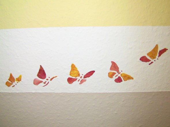 Schmetterlinge mit Schablone aufgetragen