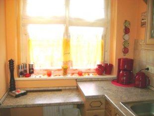 Küche wie eine Orangen-Tomate